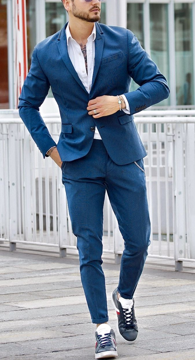 Aqua blue suit with white shirt and
