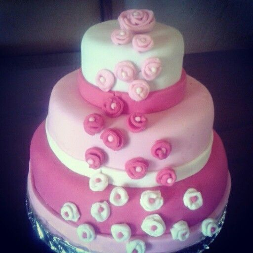 Homemade chocolate cake with pink and white fondant icing.