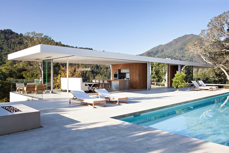 Location/ Marin, California Architect/ Jensen Architects Built/ 2013 About/ A plinth and a pavilion. Nestled into the hillside, the long, solid plinth contains the private rooms of the house. Atop this plinth sits a transparent living and dining pavilion that opens up completely for access to the outdoor decks, pool patio and expansive views to …