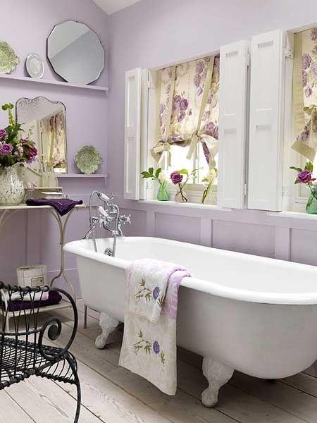 Pretty use if lavender walls, monochrome and beautiful printed blinds. The easy way to bring florals to your home