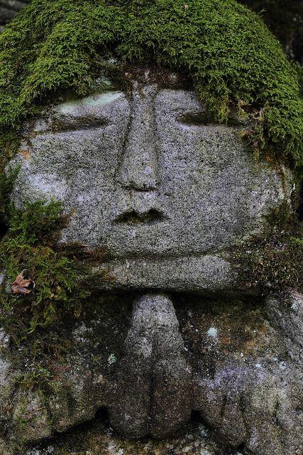 The moss seems to be a real hair on this stoned statue.  Located : Otagi-Nenbutuji Temple, Oku-Saga, Arashiyama area, Kyoto