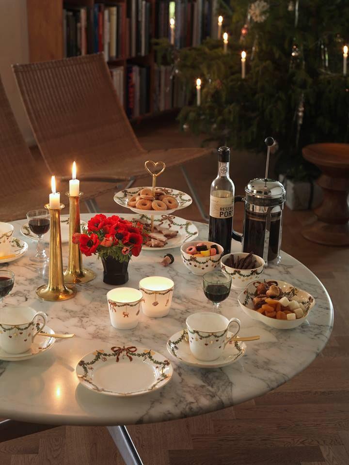Royal Copenhagen star fluted dinnerware.  PK22 chairs