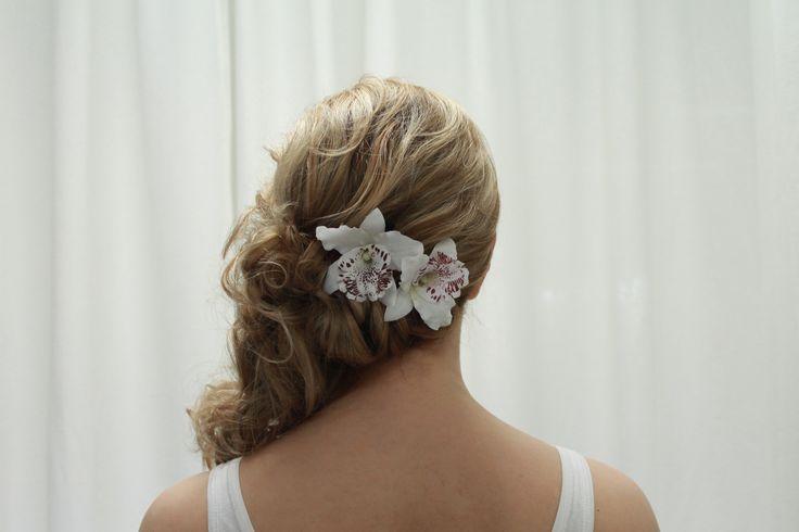 Lovely curly, messy hairdo on blond hair. Hair by Emmi/Parturi-kampaamo Salon Maria Seinäjoki