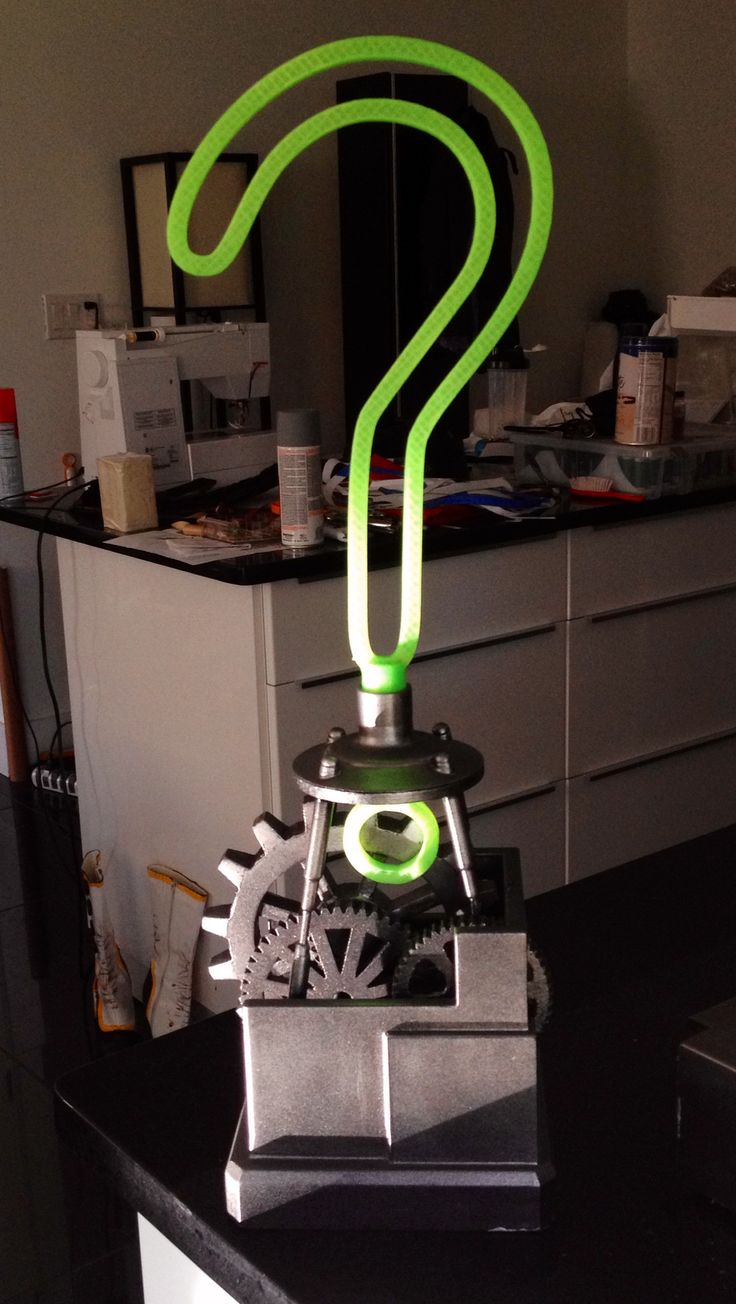 "Hey diddle diddle, tell me a riddle! 3D printed Riddler trophy, inspired by Batman: Arkham City.  Gears and ""stand"" on the interior of the trophy are printed as individual pieces and glued into place. They do not spin :/  Question mark is painted in translucent green PLA and looks almost lumi..."