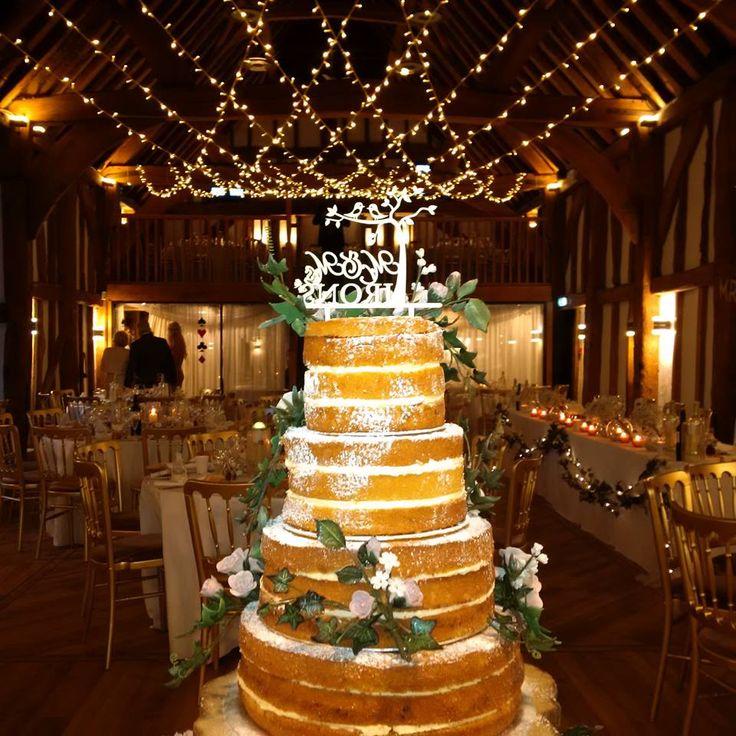 A 12 string Cross Over Fairy Light Canopy in True Warm White at The Tudor Barn Burnham #weddinglighting #buckinghamshire #eventprofs #fairylights #wedding