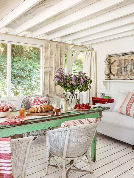A new back porch is faux-aged with old wicker and distressed paint.