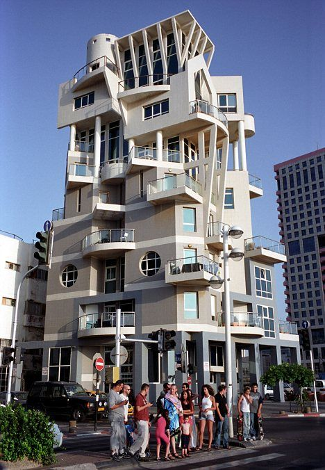 In Tel Aviv - this is either a hotel or an apartment building.  Tried to research it but can't find a definite answer. It might be the Art + Hotel building.