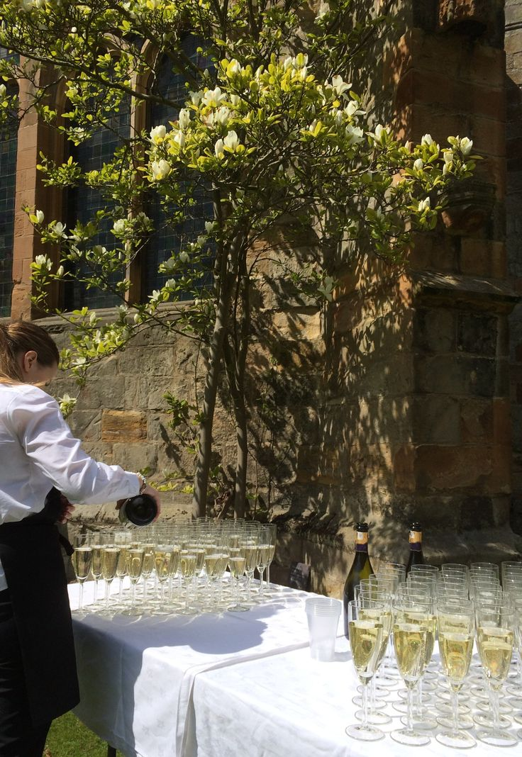 A toast to the newlyweds - Prosecco under the Magnolia at Seton Collegiate Church