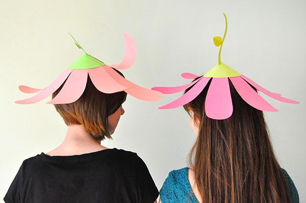 Really simplistic versions - but perhaps making it from tissue paper and adding layers.  Construction may be simple and easy to use... Paper Flower Party Hats | Oh Happy Day!