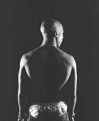 Tupac Shakur muscular body.