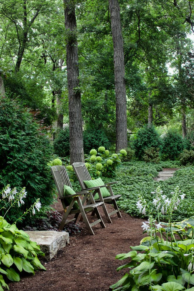 backyard oasis Traditional Landscape Designs Other Metro bushes Forever Home green flowers green throw pillow hosta Hursthouse mulch outdoor wood chair pachysandra path pathway peaceful Private private garden Secluded shredded bark pathway shrubs stone pavers tall tree walk walkway white flowers woodland