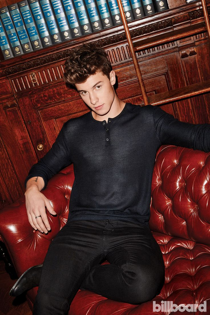 Mendes wears a Sandro sweater, The Kooples jeans and Saint Laurent boots.
