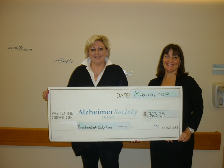 Solo Cable Solutions Stacey Farrant presents the Alzheimer Society of Brant a cheque in support of their coffee break