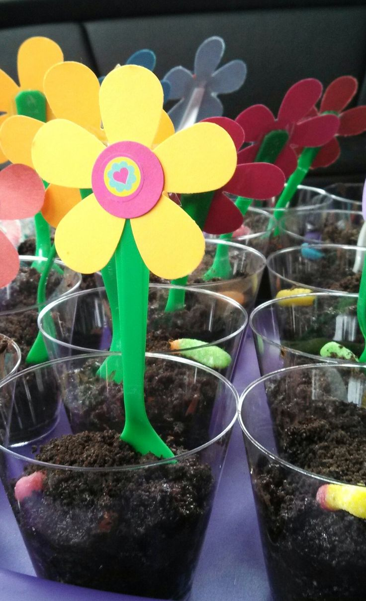 worms in dirt dirt cake bake sale idea served in a punch cup with a green flower spoon