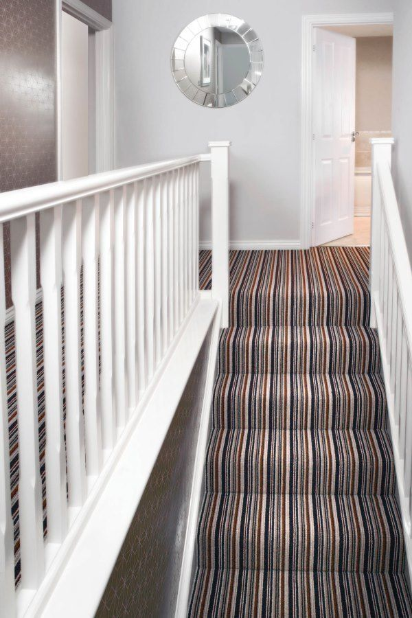 Create a focal point in a room by using bold stripes. Keep the rest of the decor plain to really make an impact. Using carpet for this is perfect way to get stripes into your interior.