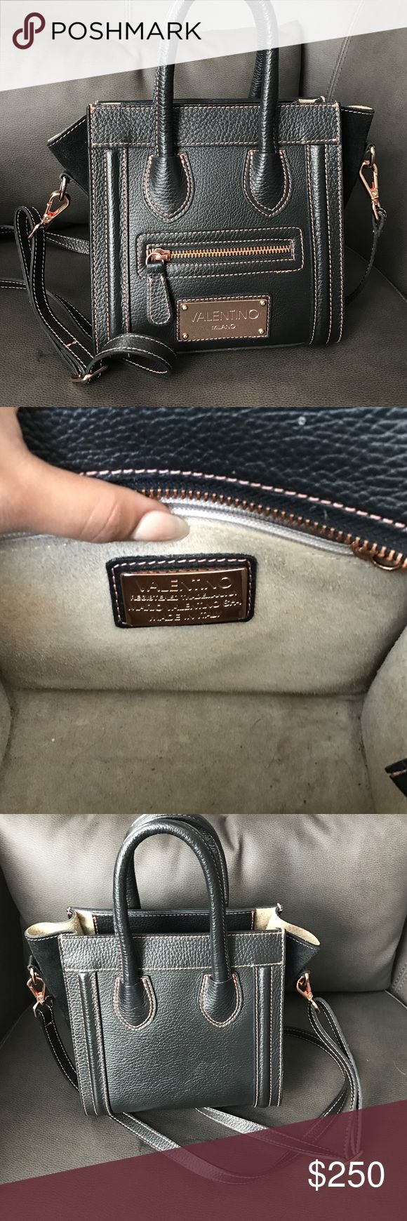 Leidy Valentino crossbody bag Like new cross body bag. Authentic comes with dust bag and tags. Picture of the interior is before cleaning. Before sending I will fully clean. It'll be just like brand new! No marking on bag at all Valentino Bags Crossbody Bags