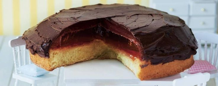 Our giant-size jaffa cake recipe is topped with zesty orange marmalade, jelly and rich dark chocolate ganache.