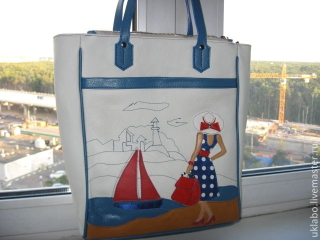 "Genuine leather from Italy. ""Crimson sails"". Application are made of genuine leather too. There are a large section with zipper inside, two slightly smaller sections, each closed with a zipper. There are external pocket and two pockets inside for small items. The main colors of the bag are light beige, blue, red. bottom 6 x27cm height 34 cm #handmade #genuine #leather #bag #blue #beige #red #marina #crimson #sails To order. 28November2015 price 158$USA"