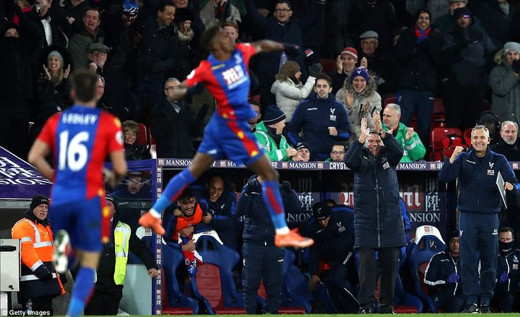 The former Manchester United attacker jumps for joy as manager Sam Allardyce celebrates on the Selhurst Park touchline