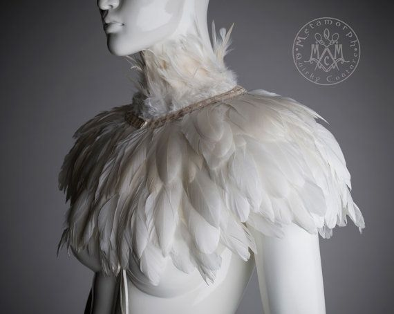 This feather collar or capelet has four rows of gorgeous ivory white feathers, one turned upwards to make the high collar and three turned downwards.
