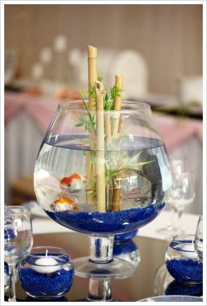 fall bamboo wedding centerpieces | fish bowl centerpiece is very unique. Fill up a fish bowl with blue ...