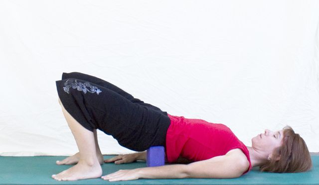 Relieve Back Pain with the Supported Bridge Pose