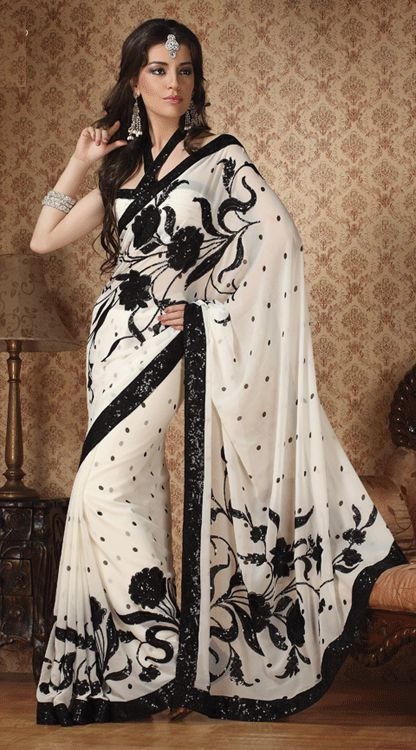 "Saree from SanginiOnline.com.  ""Off White Color Shimmer Georgette Saree""  $97? = 95 (saree) + 2 (edging) + ? (shipping)."