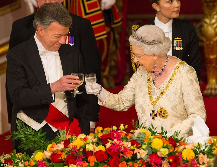 The Queen toasts Colombian President Juan Manuel Santos during a State banquet held in his...