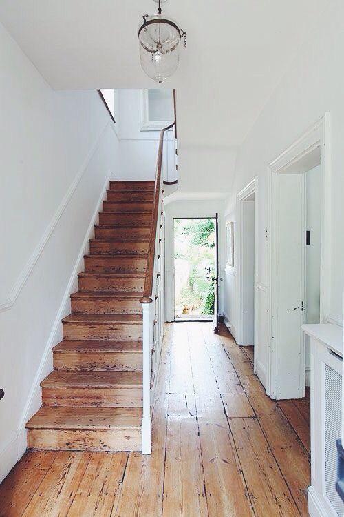 Edwardian entrance hallway stripped wooden floorboards white walls