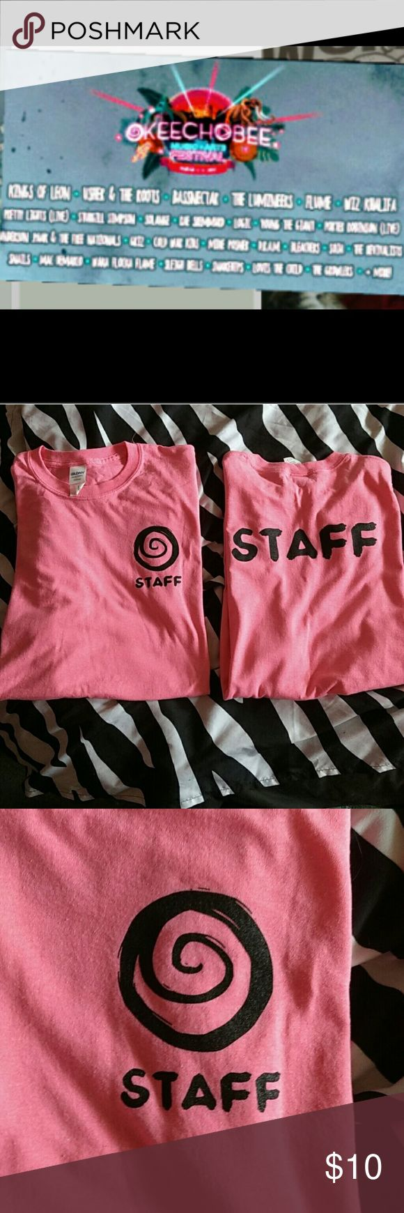 2017 Okeechobee Music Festival staff shirt Pink 2017 Okeechobee Music Festival staff t-shirt the front has the Okeechobee symbol and says staff and the back says staff, right now I have to in a size large but will be getting more, always check back for festival shirts. My boyfriend works for all of them! Firefly, Coachella, Bonnaroo etc... (Also NASCAR RACES) FOR MEN OR WOMEN! YAY! FESTIVAL TIME!!!! ?????? BRAND NEW NEVER WORN Gildan Shirts Tees - Short Sleeve