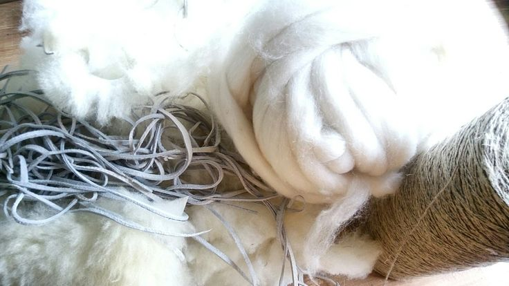 Lovely choice of materials for amazing rug. Chunky wool,sheepskin cut to thin strips, linen cord and leather.