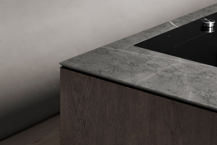 The counter top is Pietra Grey marble, a color light enough to make nature's own changing patterns apparent, yet dark enough to keep the balance between light and dark so crucial for this home.