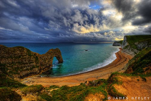 Durdle Door Arch off chalk cliffs of the Jurasic Coast in W Lulworth England by James Neeley