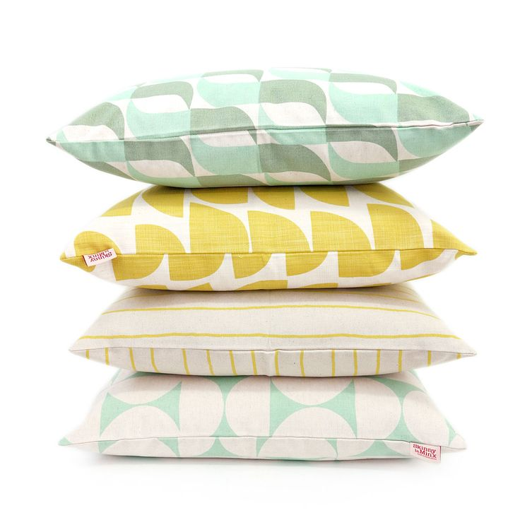 Selection of pastels and yellows in the cushion covers by Skinny laMinx featuring the  'Aperture' 'Bowls' 'Simple Stripe' and 'Breeze' designs.