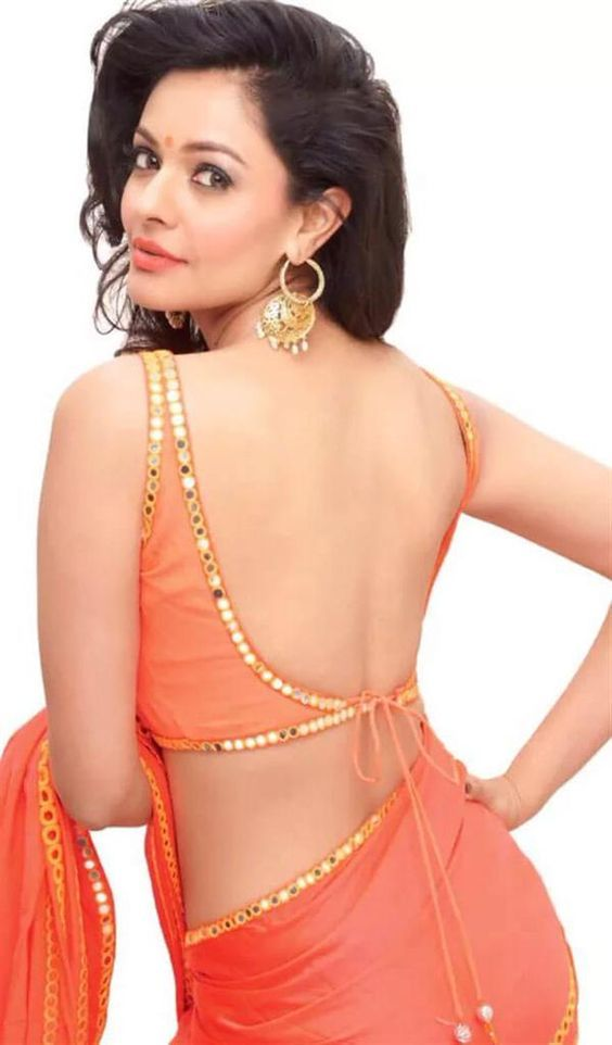 Peachy orange saree with backless string blouse