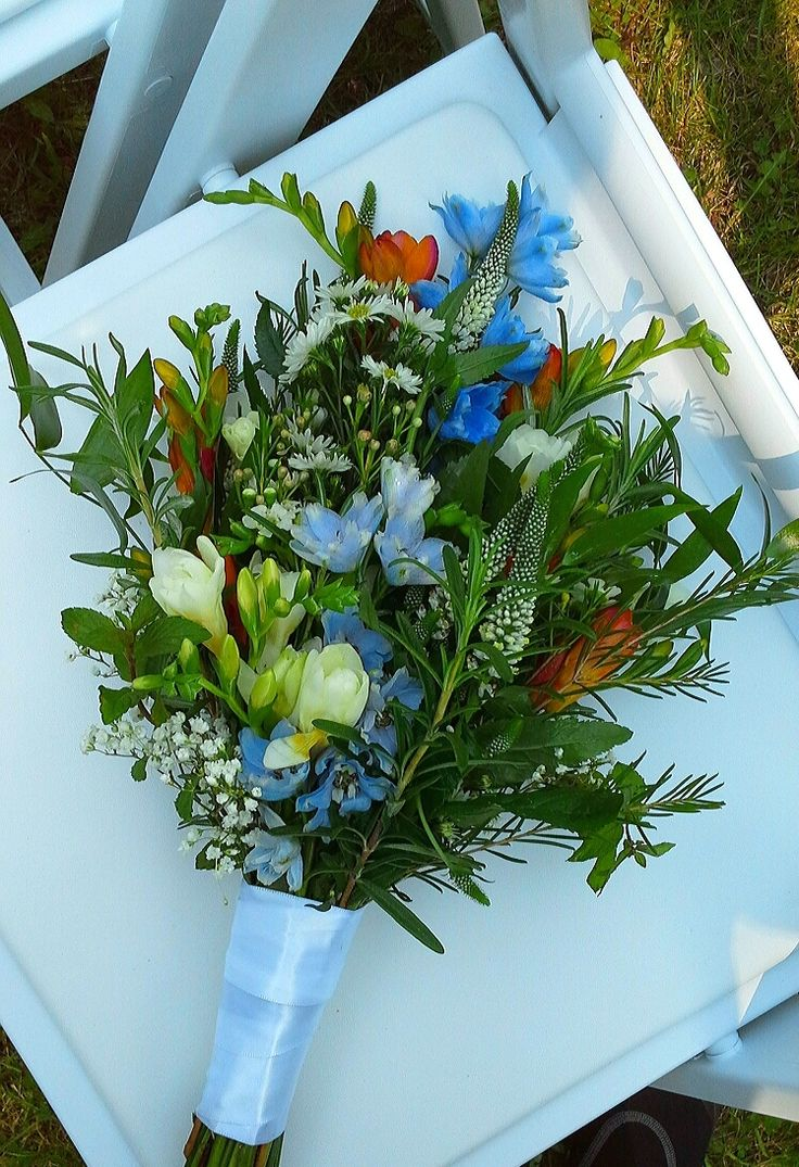 wildflower bouquet of freesia, delphinium, waxflower, rosemary, Italian ruscus, veronica, mint. aster and babies breath; design by Davis Floral Creations