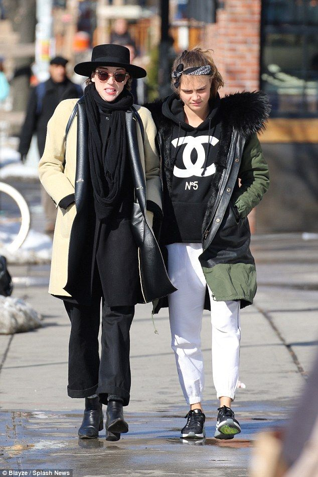 Are they together? Cara Delevingne and St. Vincent were spotted for the first time since their reported 'romantic clinch' at the BRITs when they stepped out for a leisurely stroll in New York on Monday afternoon