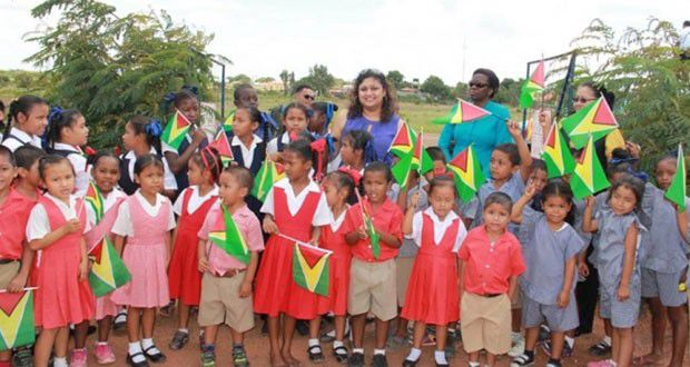 School children. Guyana, Guyana flag