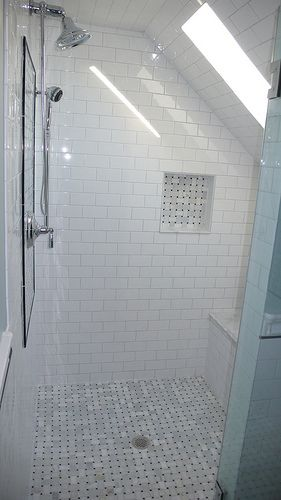 Our shower -- basketweave marble floor and accents, white subway tile surround, skylight