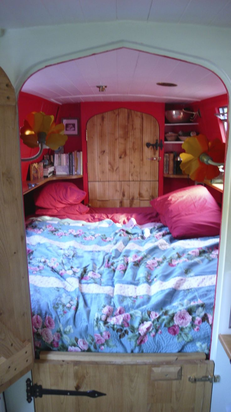 End of boat snug - King size bed that fills the entire space, window above