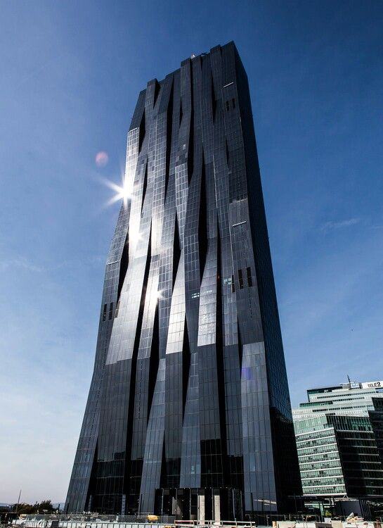 DC Tower 1 by Dominique Perrault Architecture -Vienna  The exterior facade bestows the tower with a liquid immaterial character. The tower promises a reassuring physicality.