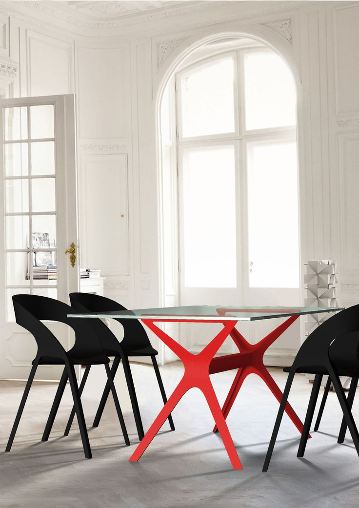 Our award winning VELA table, featured with the Carla chair