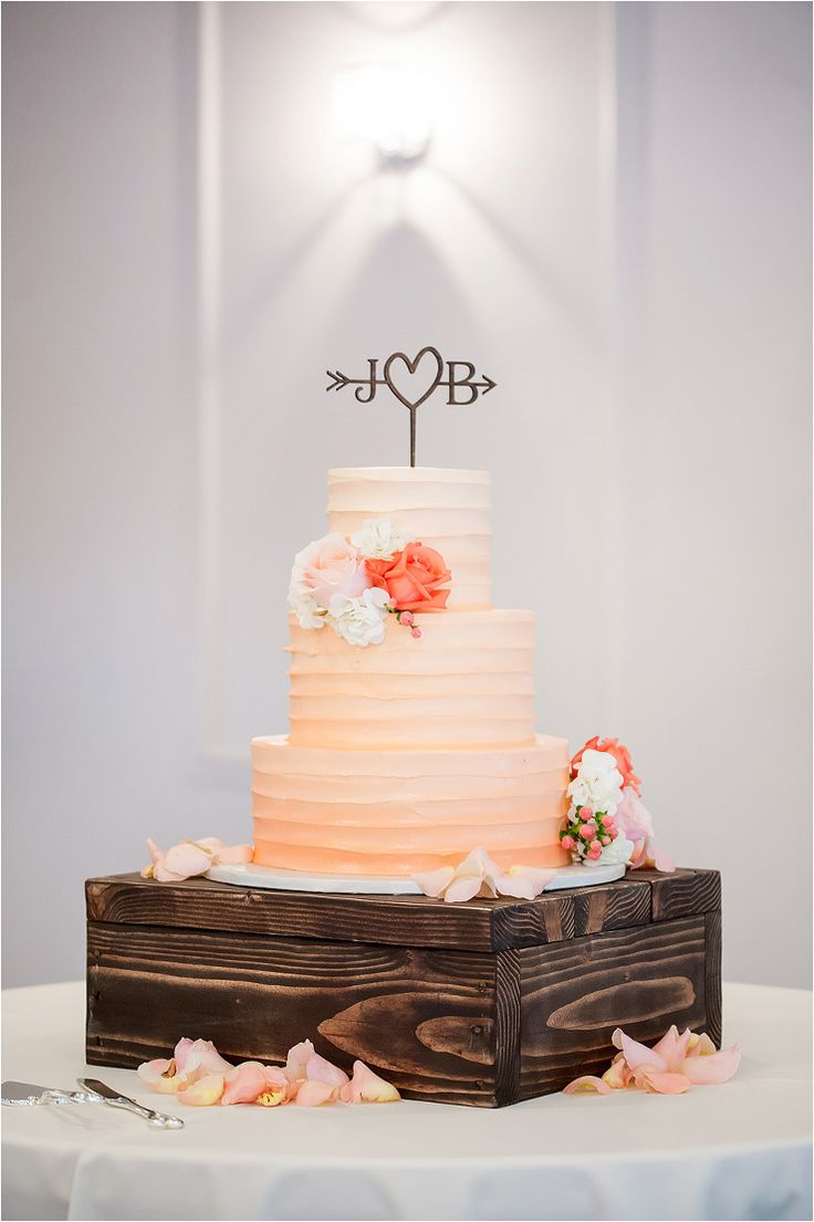 Romantic Peach Grove Wedding cake with ombré frosting and peach flower details. Cake was placed on a rustic wooden box and custom unique cake topper - Photos by Drew Brashler Photography