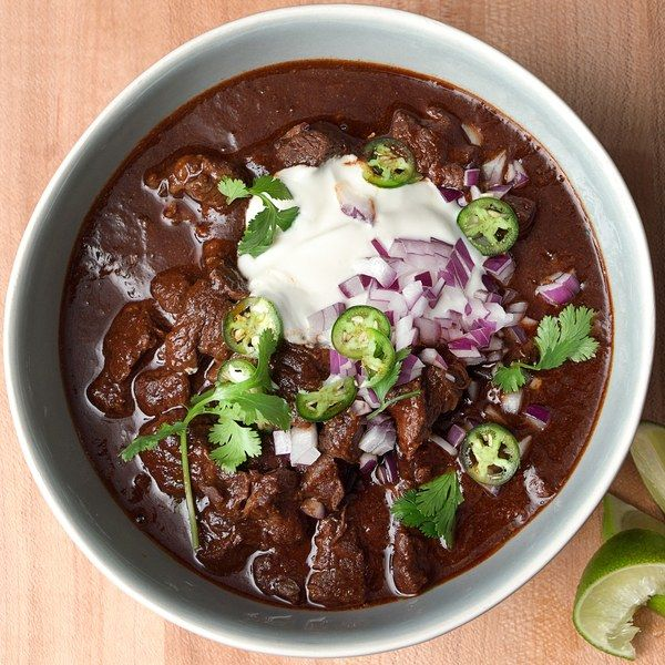 "This cowboy-style ""bowl of red"" is all about tender chunks of beef chuck and a five-chile-pepper purée. True to Texas tradition, it has no tomatoes and no beans. The heat is customizable to your taste, and don't skip the masa harina: It helps to thicken the chili and imparts a wonderful earthy richness. This chili is best served a day after cooking."