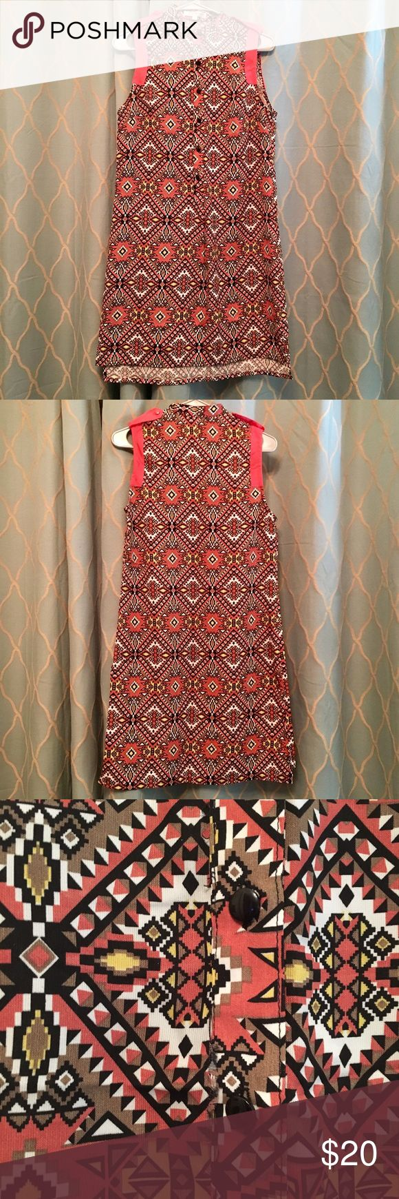 Joy Joy Aztec Print  Sleeveless Dress Lovely Aztec print dress from Joy Joy in size small. The pattern includes several colors including coral, brown, black, yellow, and cream. Dress is a light material made of 100% Viscose. Cute button detail in front of Dress allows one to create different looks with or without necklaces. Worn 2-3 times, in excellent condition! Joy Joy Dresses