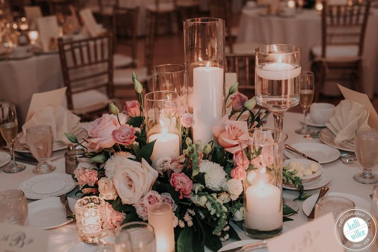 Candlelight adds a fairytale glow to the centerpieces for Ashley and Patrick at DuPont Country Club. Kellie Wilke Photography