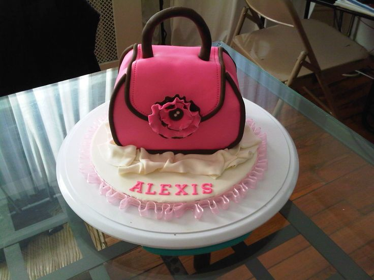 Purse cake - purse cake for 10 year old little girl. pink and brown MMF . strawberry cake with chocolate ganache. I followed the tutorial on here by jessicakes.. My cake did not come out as beautiful as hers but her instructions were awesome and very easy to follow. Thank you for the tutorial..