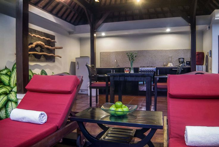 Bali Villa Photography - Ulin Villas - pool lounge chairs with dining bale in background night time