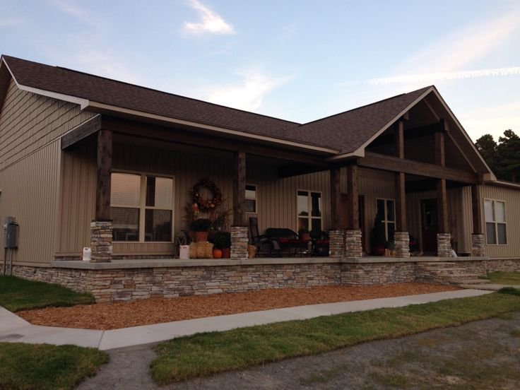 Our house! Dry stack rock. Large open front gable. Cedar stained columns. Vertical vinyl siding.