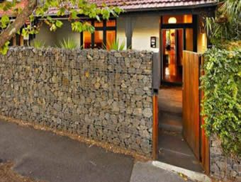 A house using gabion wall instead of common chain link fence